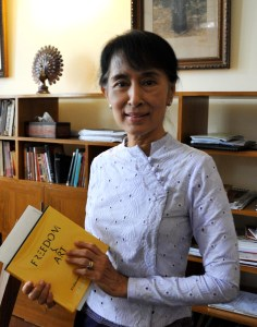 "Myanmar's Aung San Suu Kyi holding our ""Freedom & Art""book in her hands"